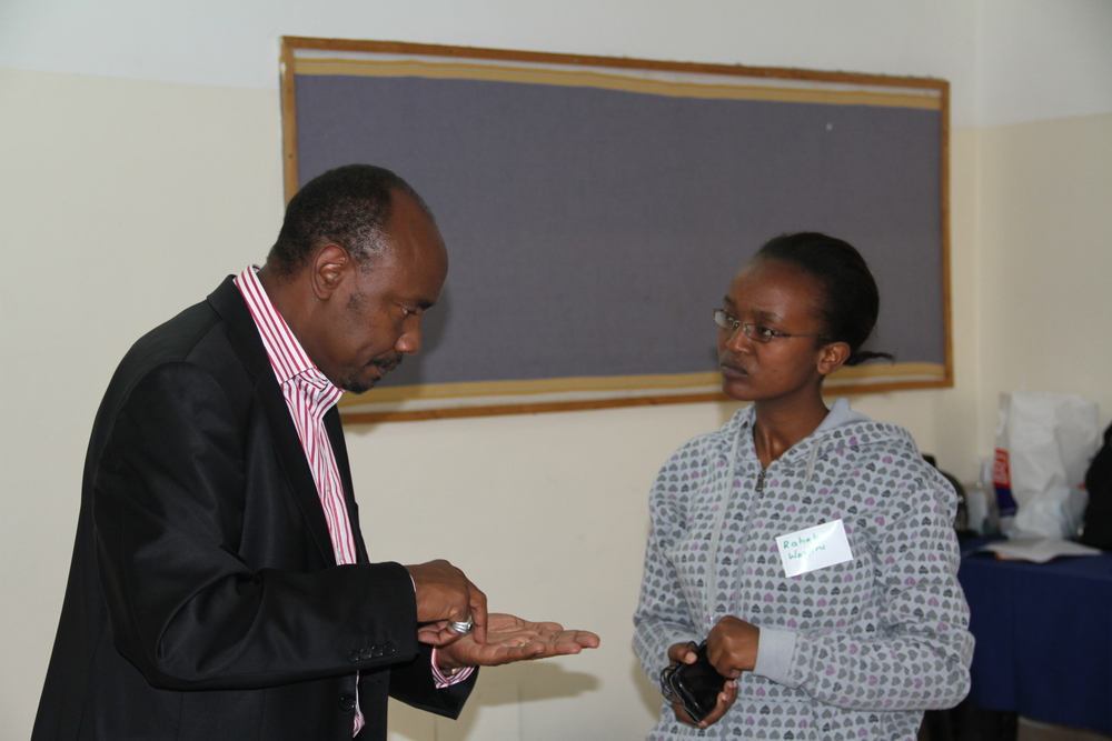 Ken Njiru of Uungwana Initiative with a political student aspirant during the 2015 Emerging Leaders Workshop.