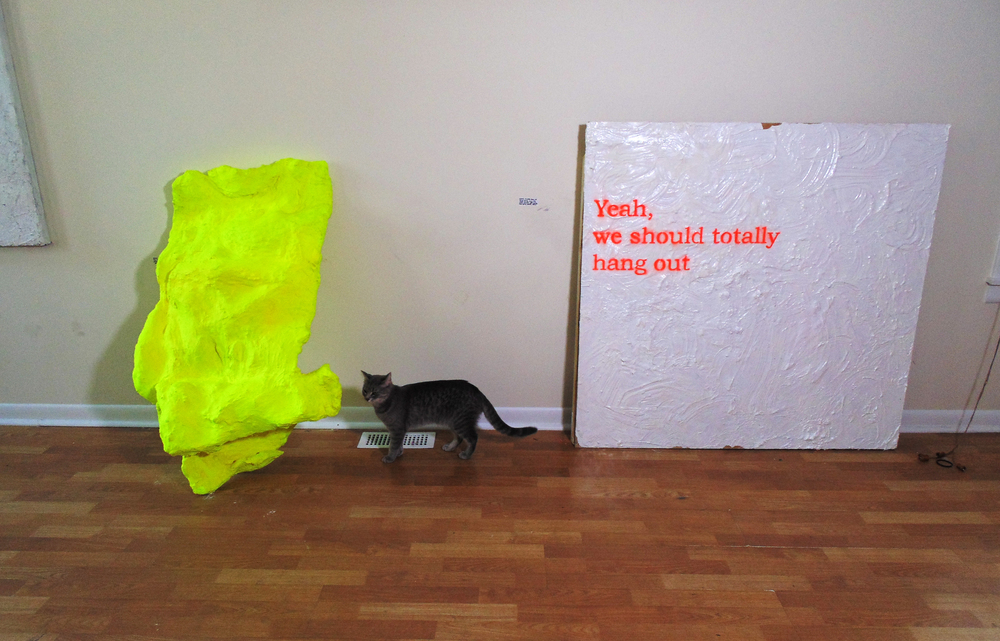 "installation shot of )( gallery's ""giving up"". i swear i'm a wallflower (left) next to caitlin mattia's yeah, we should totally hang out (right). 2014. cat (pussy riot) pictured for scale reference."