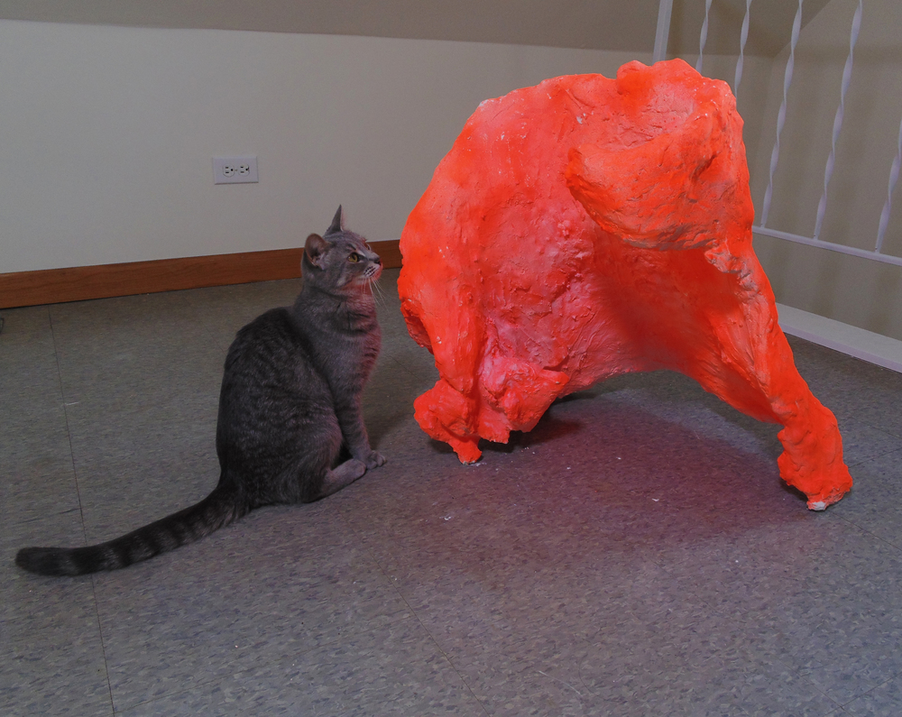 installation shot of (pussy riot the) cat next to fighter (sculpture). 2014.
