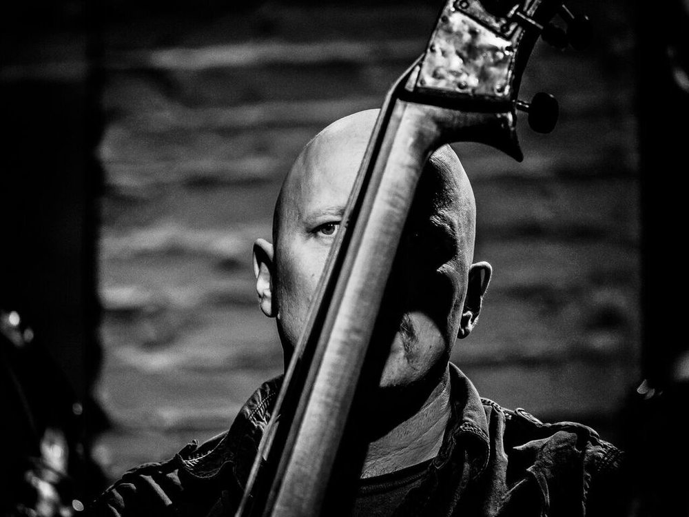 Ingebrigt Haker Flaten gives a solo performance on Friday, August 10th at the Crowley Theater.