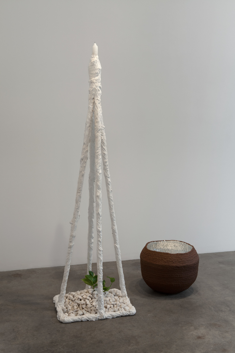 Kathryn O'Halloran,  Basic Connecting Station,  2015, plaster, candle, rocks, plant, stoneware, aluminum