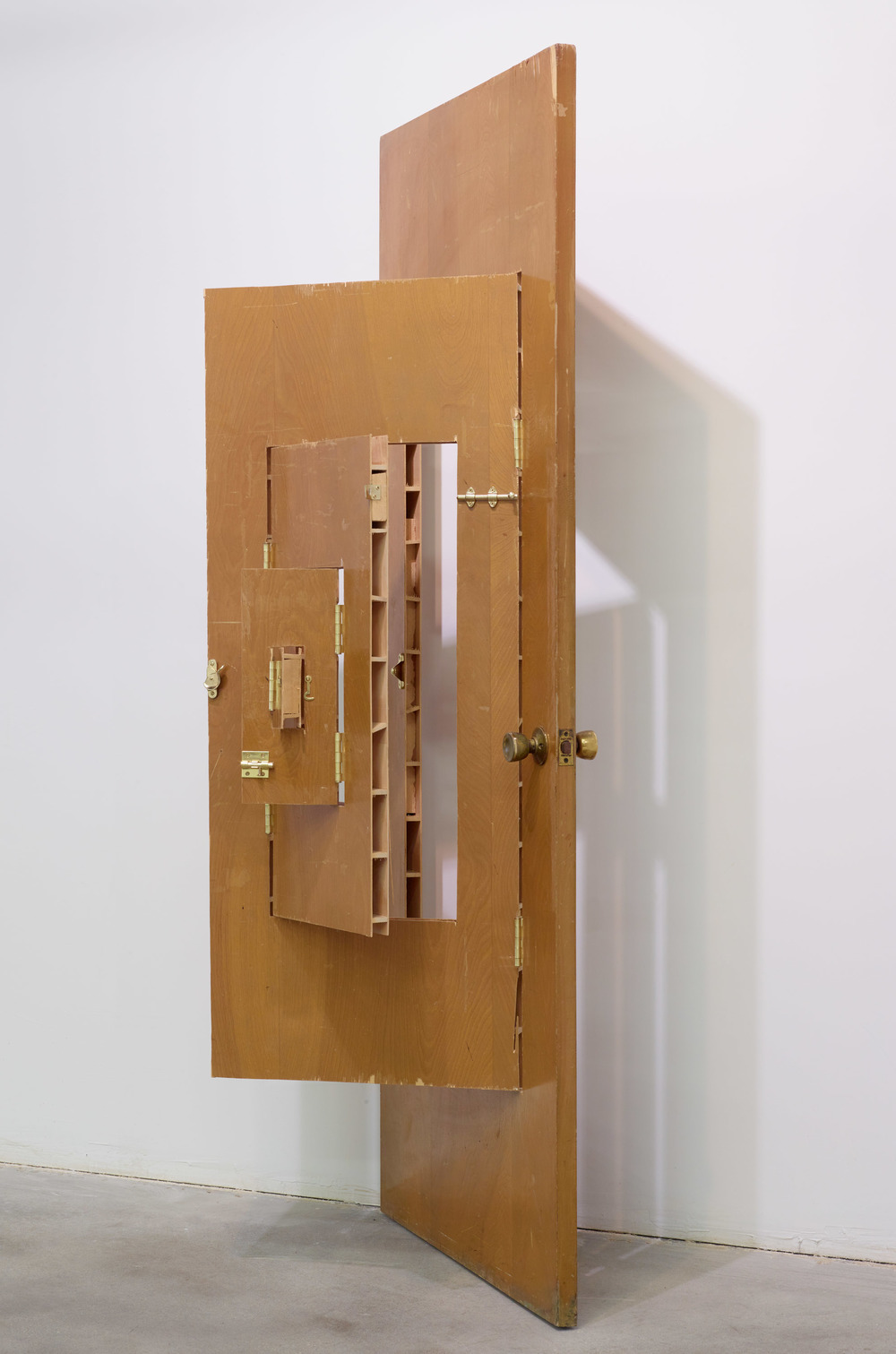 Joshua Callaghan  ,    Door #1   , 2010.   Modi ed door, wood, hardware, 79.5 x 31.75 x 6 inches folded.