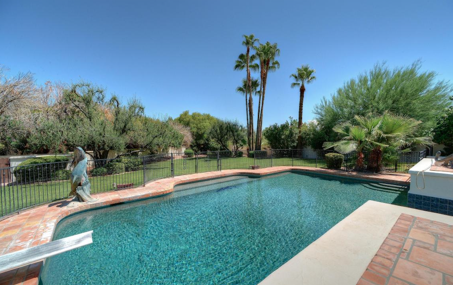 Paradise Valley stunning covered patio overlooking sparkling pool and mountain views at Finisterre $1,400,000.png