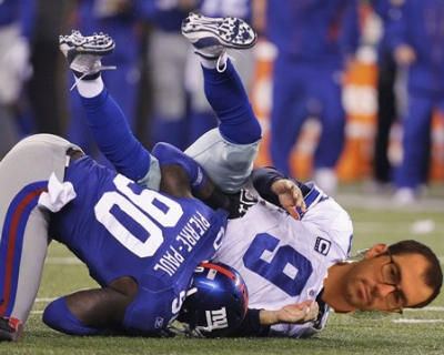 Last podcast I bet Dave that Duke would go further than Kentucky in the NCAA tournament.  I sacked Dave with my NCAA basketball foresight, so here is Dave being sacked by Jason Pierre-Paul of the New York Giants.  Tonight is the championship game, Duke vs. Wisconsin, and for the record, my money is on Duke.  Image by Julio Cortez of the Associated Press.