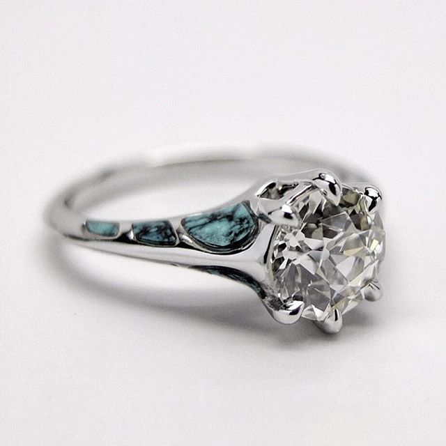 #BrayRing // Considering the #turquoise inlays in this #platinum and #oldeuropeancut #diamond #engagementring commissioned last year. I never thought I'd use turquoise, even less pull it off in an engagement ring so it still looked like my work. But I think it turned out pretty damn well. My hunch is that the contouring of the stone to the metal curves is what that made it a nice integration. I'd like to try more of this. . . . . . . . . . . . . . #derrickcruz #artist #modern #design #avantgarde  #selfmade #sustainabledesign #recycled #diamondring  #inspiration #madeinnyc #madeinusa #weddingring #uniqueengagementring #uniqueweddingring #handcrafted #craftsmanship