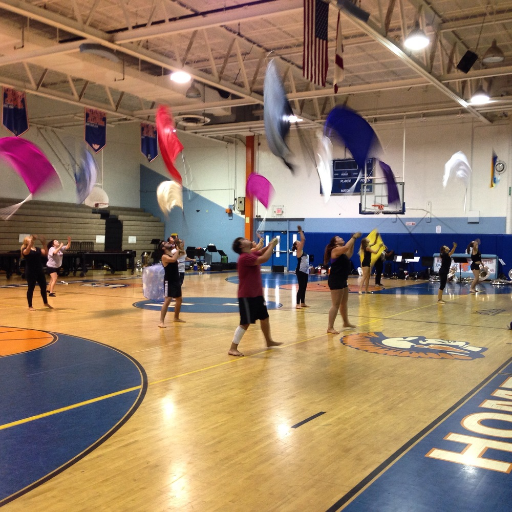 Colorguard started off 'Show and Tell' with their production they created that day!