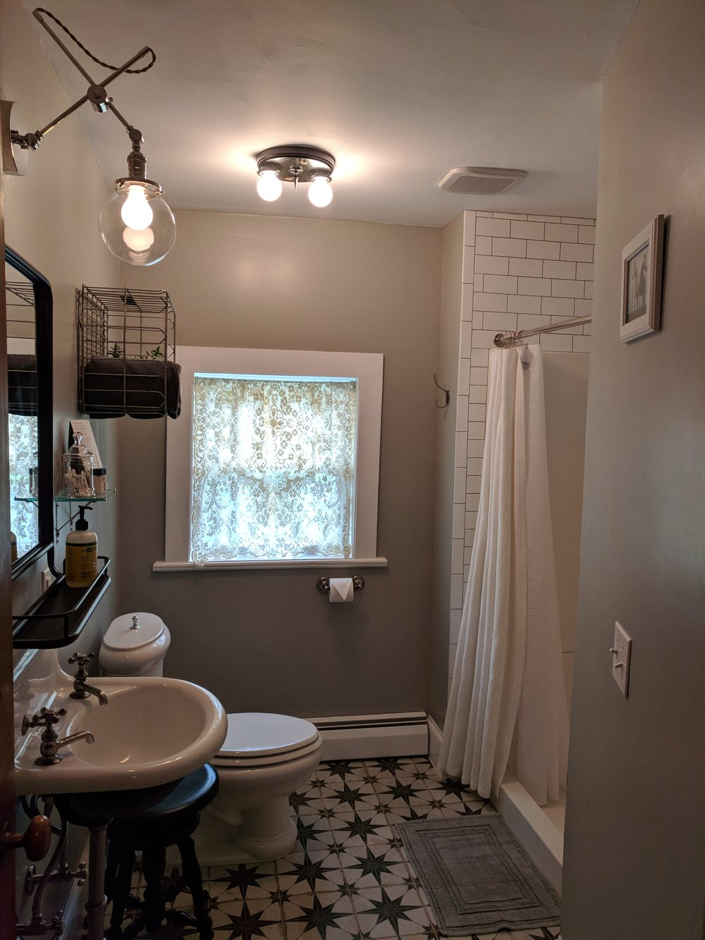 Roosevelt private bathroom with large shower and tile flooring