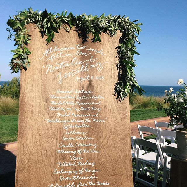 A little of 🌿 @jl_designs and @bobgailevents and a little bit of ✒️. Love seeing this 4ft by 8ft program board on its wedding day! #natandjon