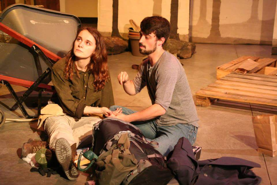 Mel (Mikayla Sherfy) waits as Jonathan (Andrew Rea) sutures her cut. Tesseract Theater, 2015