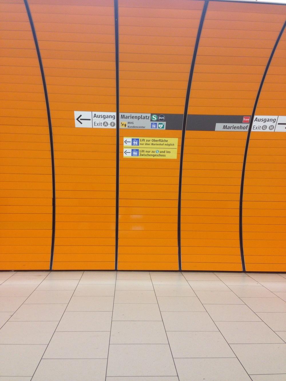 TTWMF in Munich. An orange subway station always keeps one smiling. Also German signage...