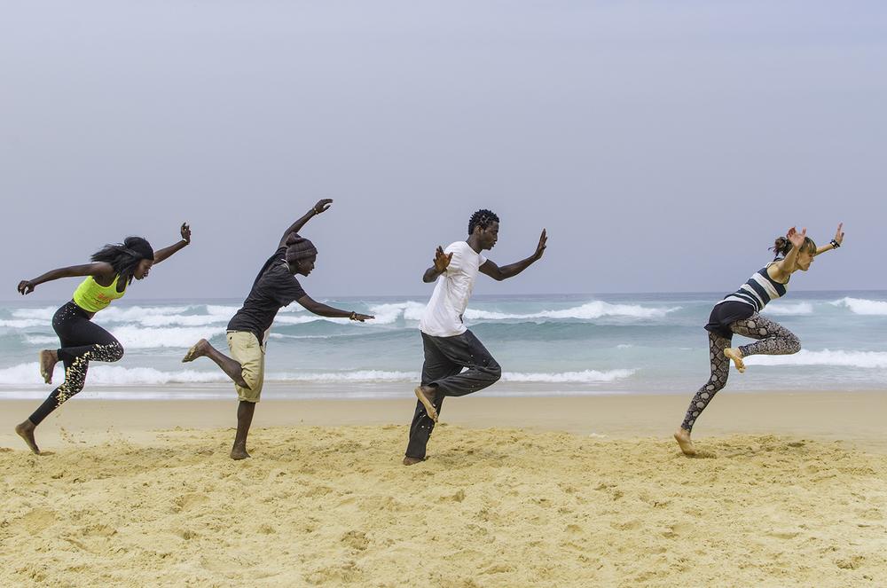 Sabar dancer's group Afrika Akay Degg practising on the beach in Dakar, Senegal.