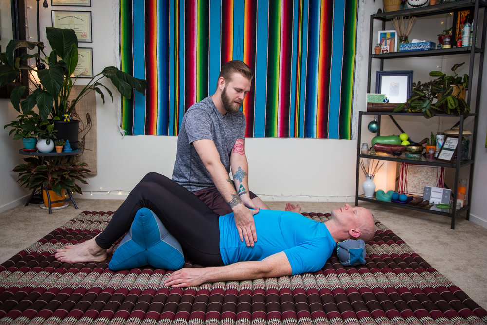 ENERGY WORK  - Energy work can be used an umbrella term to reference a variety of techniques a therapist can use to manipulate the energy in a client's body. In fact, one could say Shiatsu, or really any massage modality, is a form of energy work. This refers specifically to work done by the therapist, whether with their hands on the client's body, or hovering just above them, working to augment their energetic field. Some therapists work to augment the energy by working with the body's natural electrical polarity, or by mentally focusing healing energy on a person through thought and intention. People often report an increased sense of relaxation and well being during and after energy work, and it is great for deeply stressed individuals, or those with severe chronic pain.