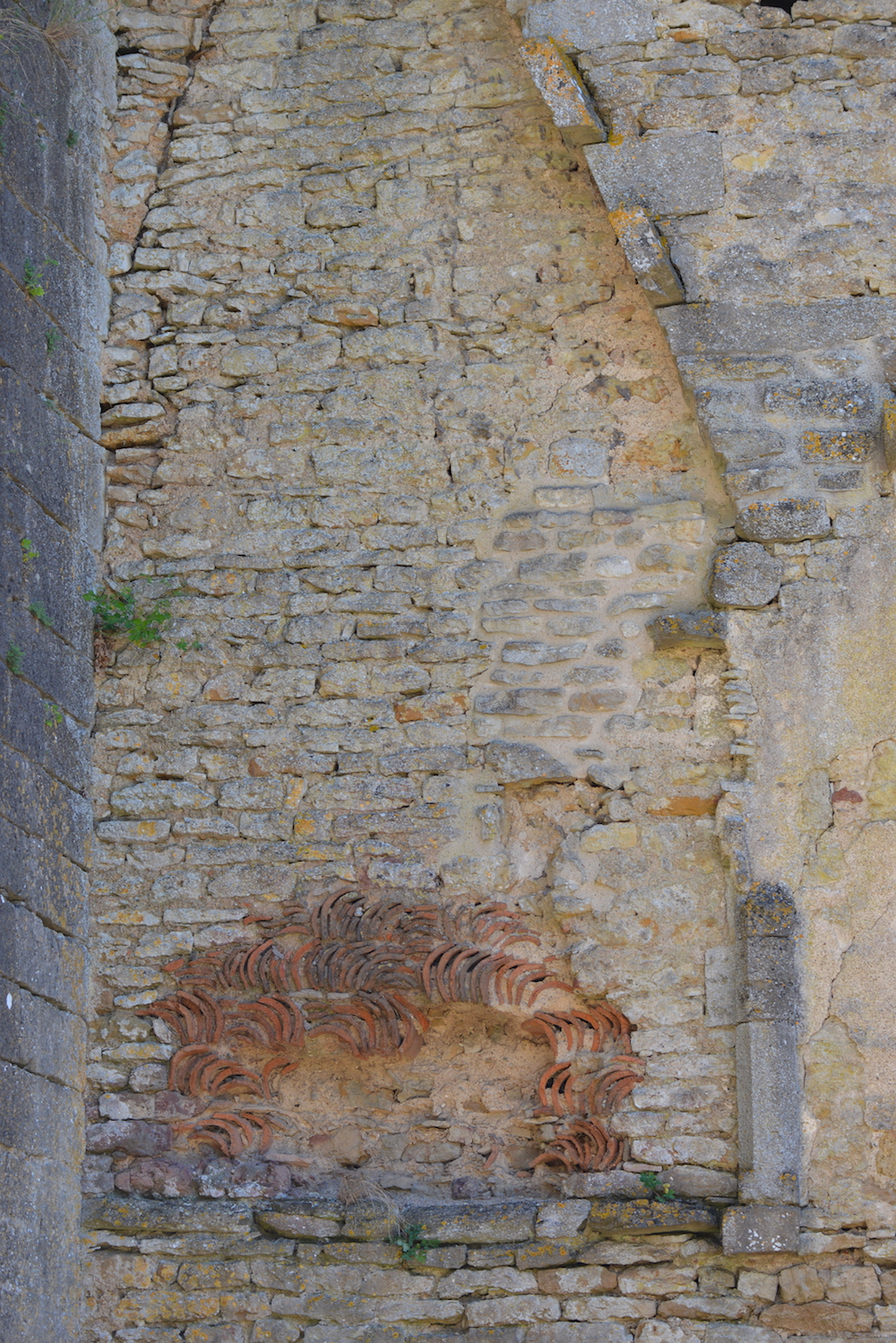 Roman tiles form the fireback of this chimney at first floor level.