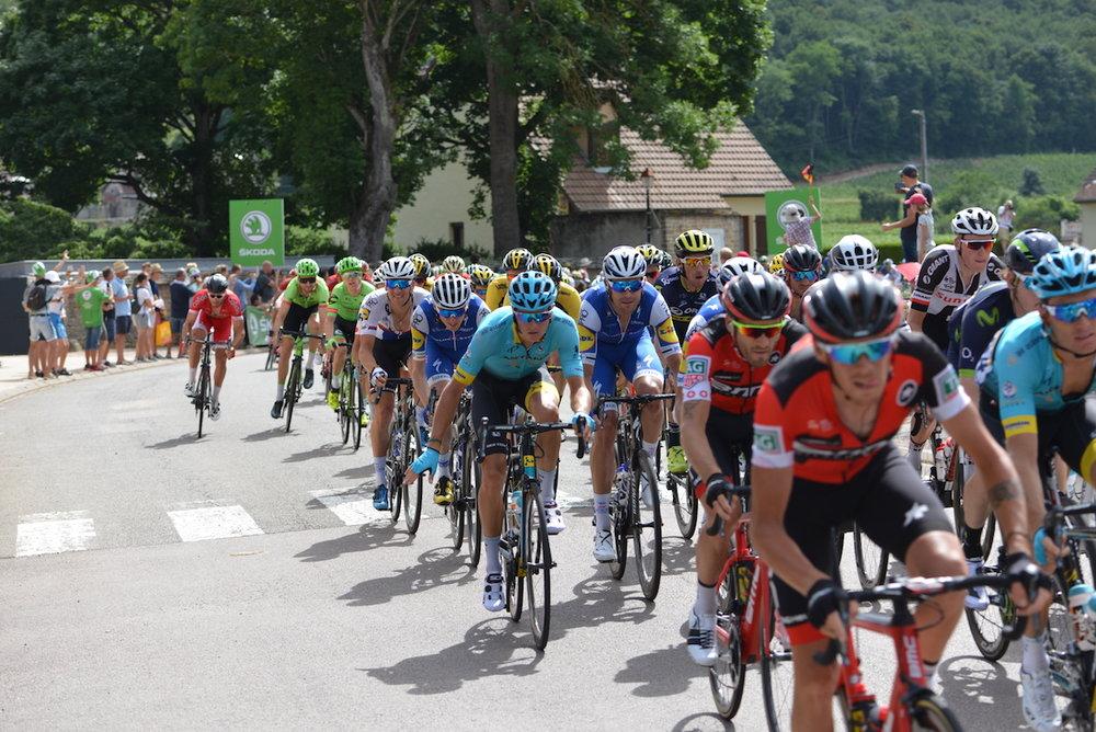 The Tour de France descending the Combe de Lavaux 7 July 2017