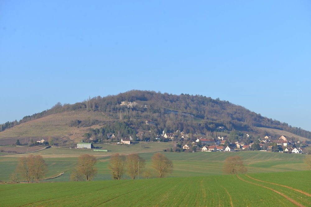 The hill of Vergy from the south - the remains of the Abbey St Vivant visible just below the crest of the hill