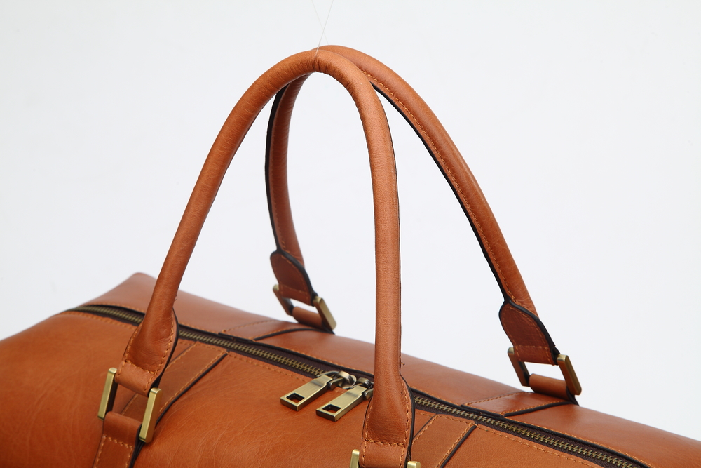 Rolled Handles  make the Weekender easy to hold on your commute to the city or weekend in the country.