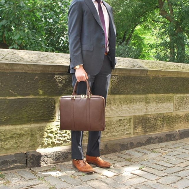 Dressed up or dressed down, the #BenchmarkBags #briefcase looks great with any look, though we're partial to suits and knit ties  #dapper #menstyle #gentlemanstyle #leathergoods #mensfashion