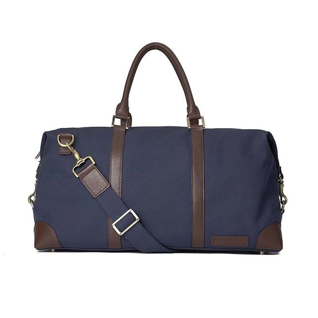 The Canvas Weekenders have arrived! Pick up yours today in moss or navy at www.BenchmarkBags.com/shop #BenchmarkBags #leathergoods #menstyle #leatherbags #mensfashion