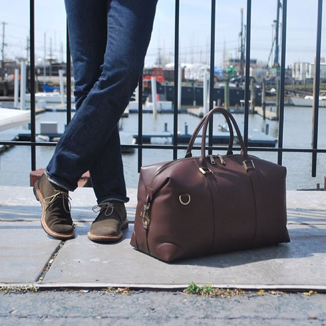What do you wear when you travel? We like #selvegedenim and #chukkaboots  #BenchmarkBags #Weekender #menstyle #gentlemanstyle #gqstyle #dapper #leathergoods