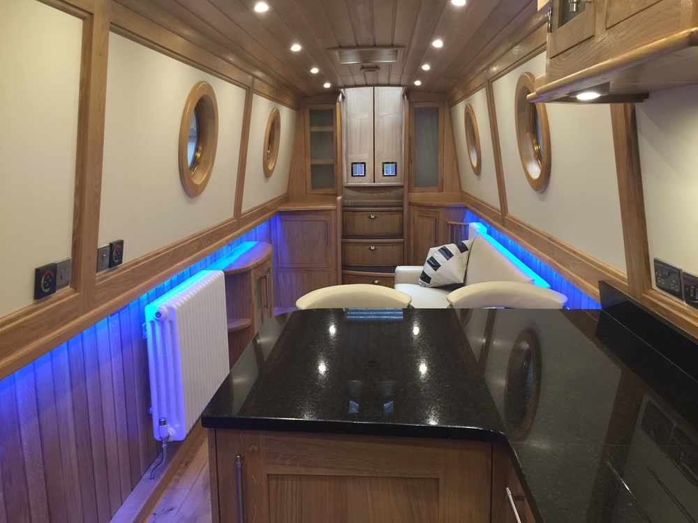Galley with sliding step access to bedroom under tug deck