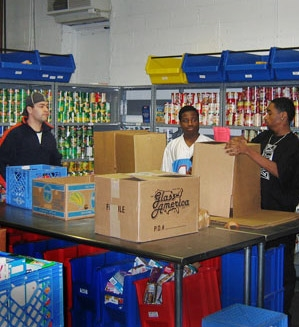 The volunteers at Manna Food Center pack boxes to distribute more than 16,000 pounds of food each day, according to Manna's 2014 annual report.