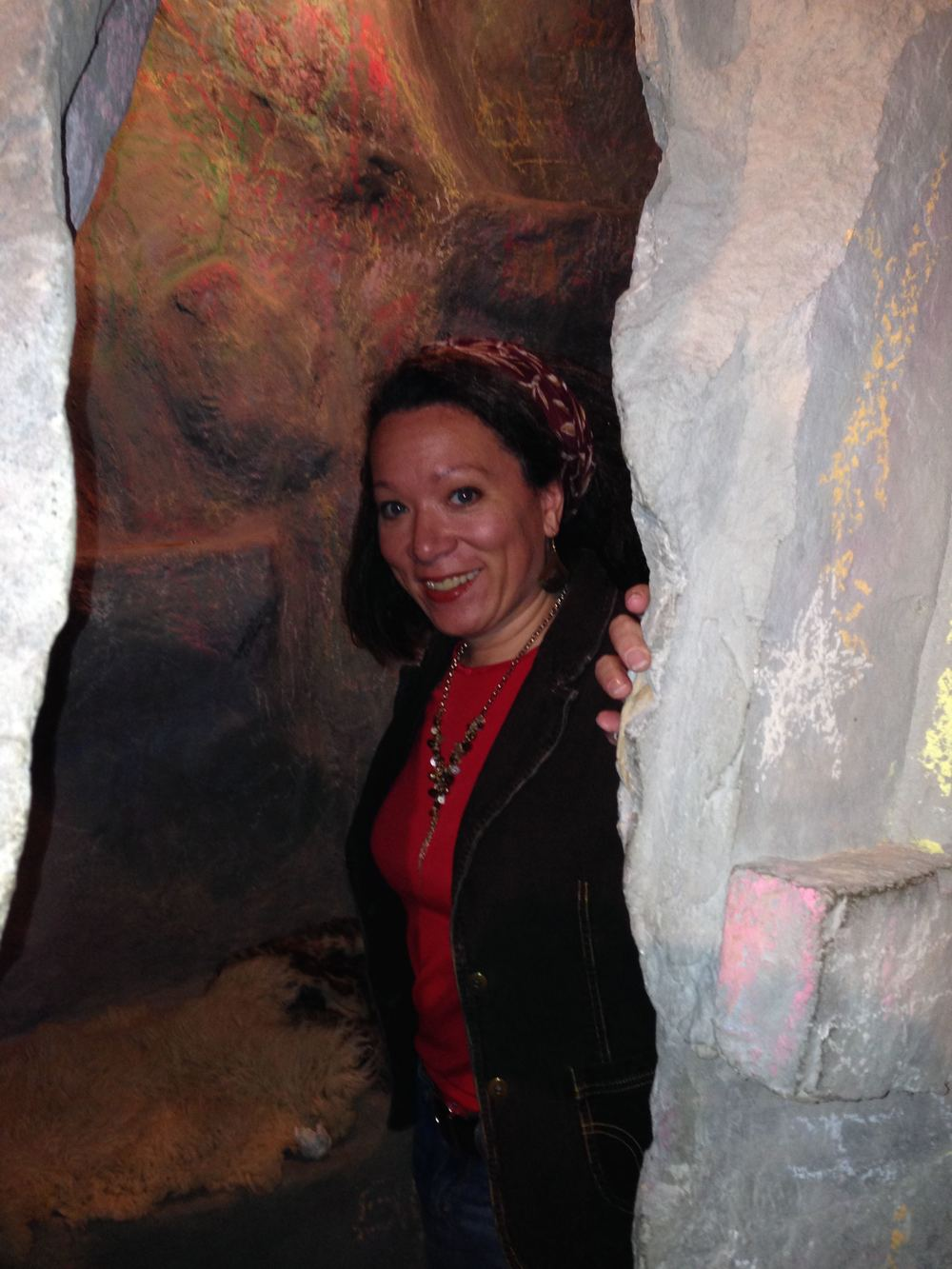 826DC volunteer Tara Campbell peeks out from the cave in the Museum of Unnatural History. Yes, there's a cave. #jealous