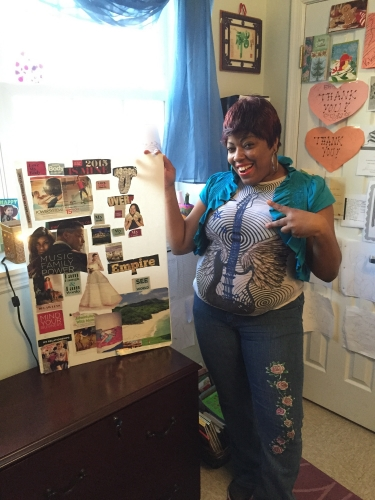 A Community of Hope housing client shows off her space/ Photo courtesy of Community of Hope