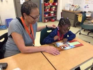 Alexis works with her student, Jada/Photo courtesy of Reading Partners
