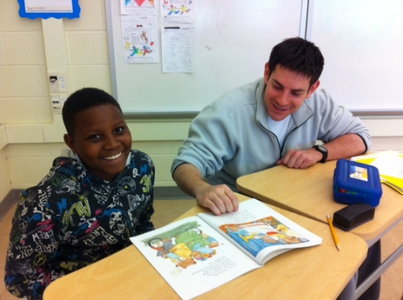 This is not a photo of Karen. Tutor Dave works with student Emmanuel./Photo courtesy of Reading Partners