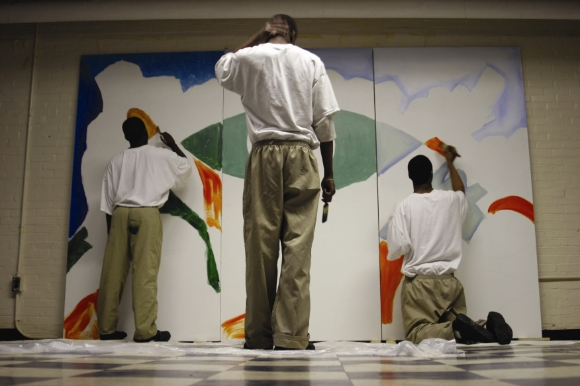 Youth create a mural through Class Acts Arts' Project Youth ArtReach program./ Photo by Joey Tomassoni