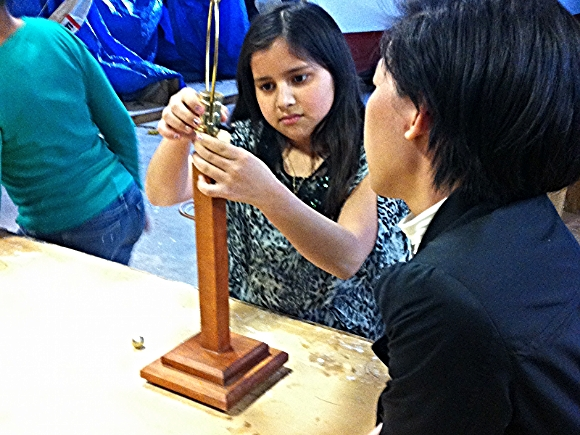 A SOHO student and mentor work on a lamp/Photo source: Patch.com