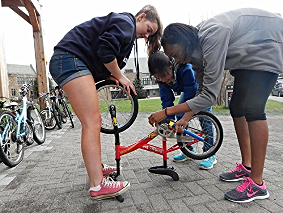 Students at The Friends School in Baltimore work on a bike./Photo courtesy of Bikes for the World