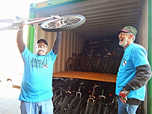 Jim loads BfW's 100,000's bike into a crate./ Photo courtesy of Bikes for the World
