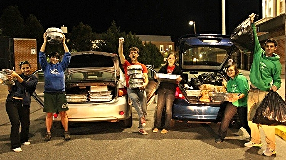 Students recover food after a football game/Photo credit:  The Washington Post