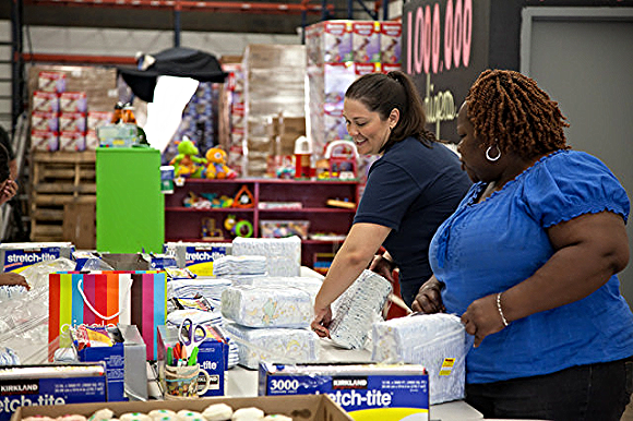 DC Diaper Bank executive director Corinne Cannon bundles diapers with a volunteer./Photo courtesy of DC Diaper Bank