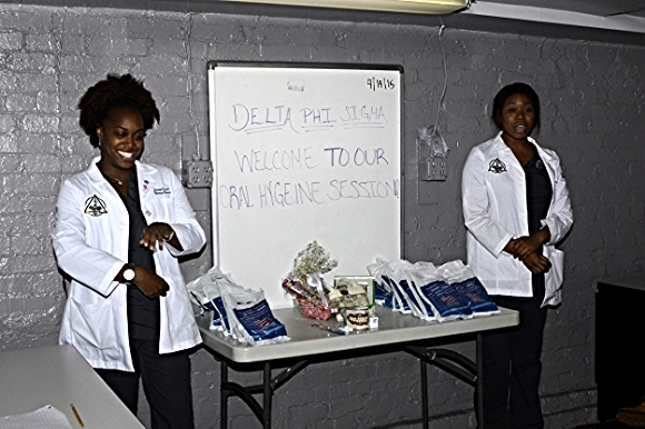 Stephanie Oboite and Sasha Bruce of The College of Dentistry at Howard University deliver a presentation on how to maintain good oral health./ Photo courtesy of Young Ladies of Tomorrow