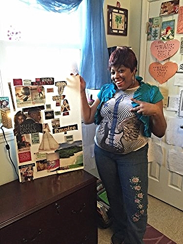 A Community of Hope housing client shows off her space/Photo courtesy of Community of Hope