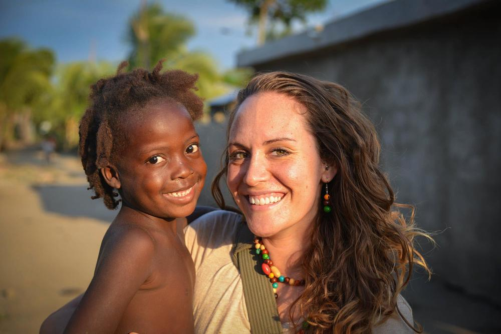 Maria Atkinson with one of the young girls she serves in Haiti. Photo © Maria Atkinson