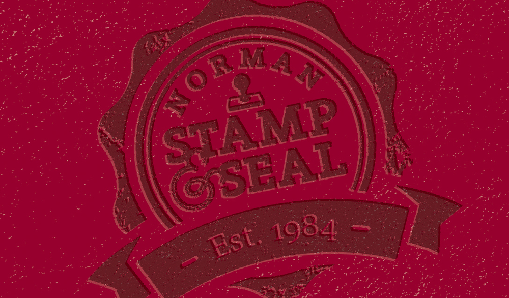 Norman Stamp & Seal Crimson Logo