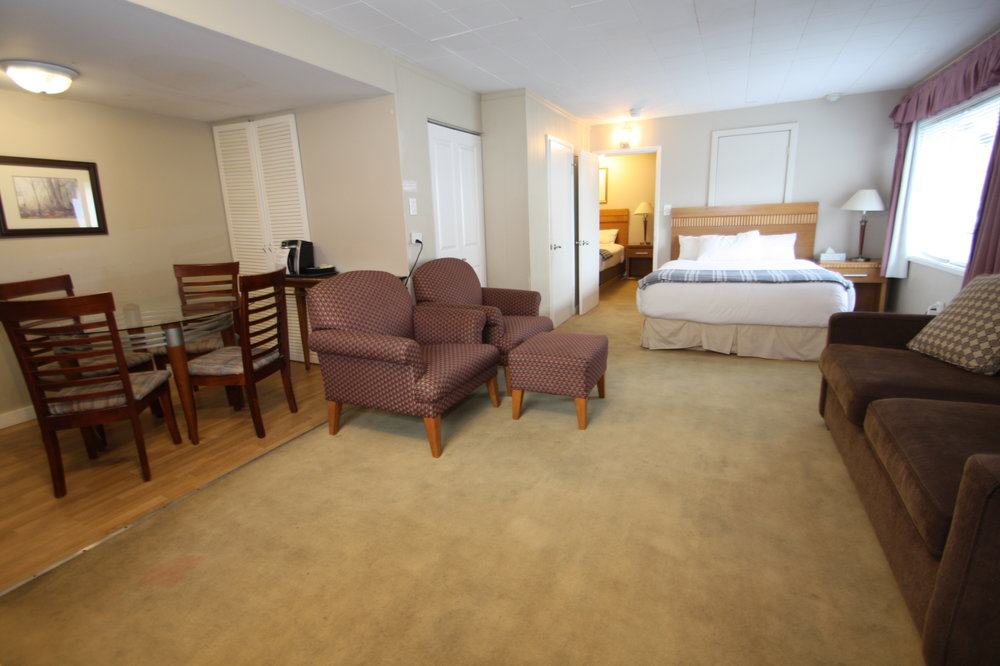 Maximum occupancy: 6 people  Our largest unit features a private bedroom with  a Queen Bed  as well as  one Queen Bed  and  one Sofa-bed  in the common area with a kitchen. Our comfortable sofa-bed provides seating and an extra bed when needed.