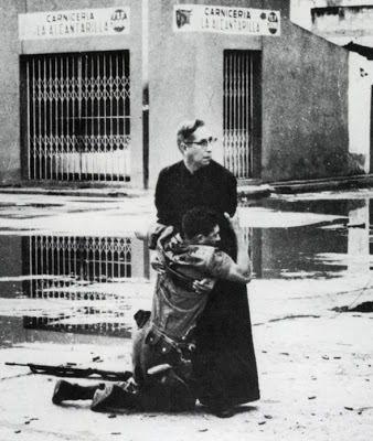 Hector Rondon, news photograph, Aid from the Padre, taken June 2, 1962, at Puerto Cabello Naval Base, Caracas during a revolt against the Venezuelan government