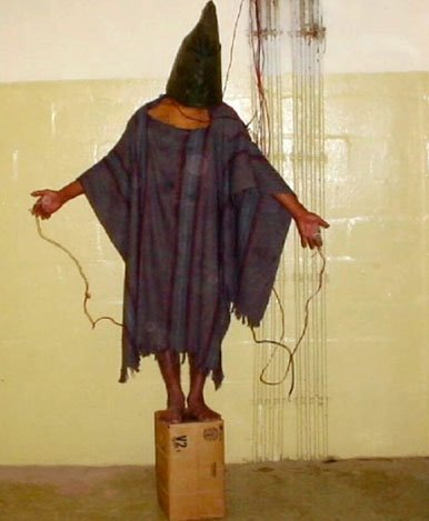 Photo credit uncertain (Charles Graner?); Prisoner at Abu Ghraib Prison, Iraq, 2004