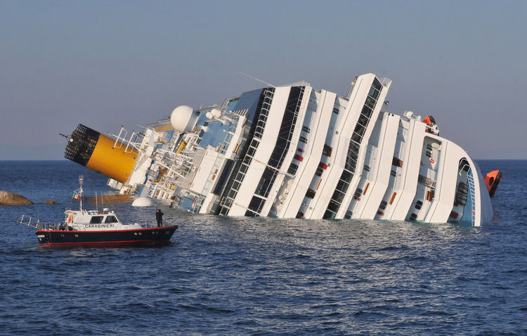 Photo credit unavailable (I tried), Costa Concordia, a ship capsized off the coast of Italy on January, 13, 2012. 32 people were confirmed dead. Its captain, Francesco Schettino, was charged with manslaughter; as of January 2015 the case is wending its way through the Italian courts.