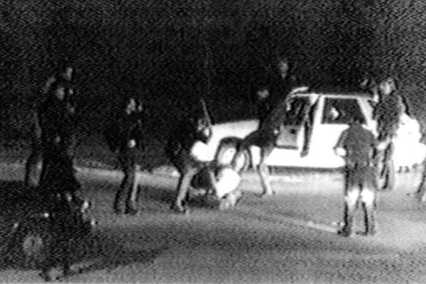 George Holliday, still image from video footage of the Rodney King beating, on March 3, 1991. Los Angeles, California. Holliday sent his footage to news station KTLA, and outrage resulted. An early example of citizen journalism, made possible by a technological innovation: the consumer grade camcorder.