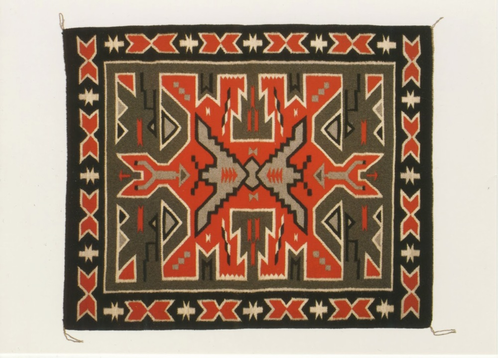 Designer Uncredited, Navajo rug from Teec Nos Pos, Apache County, Arizona. George H.H. Huey, photographer. Issued as a postcard in a set published under the title Navajo Rugs of the Southwest, undated (which I bought at the Denver Art Museum in 2008, I think)
