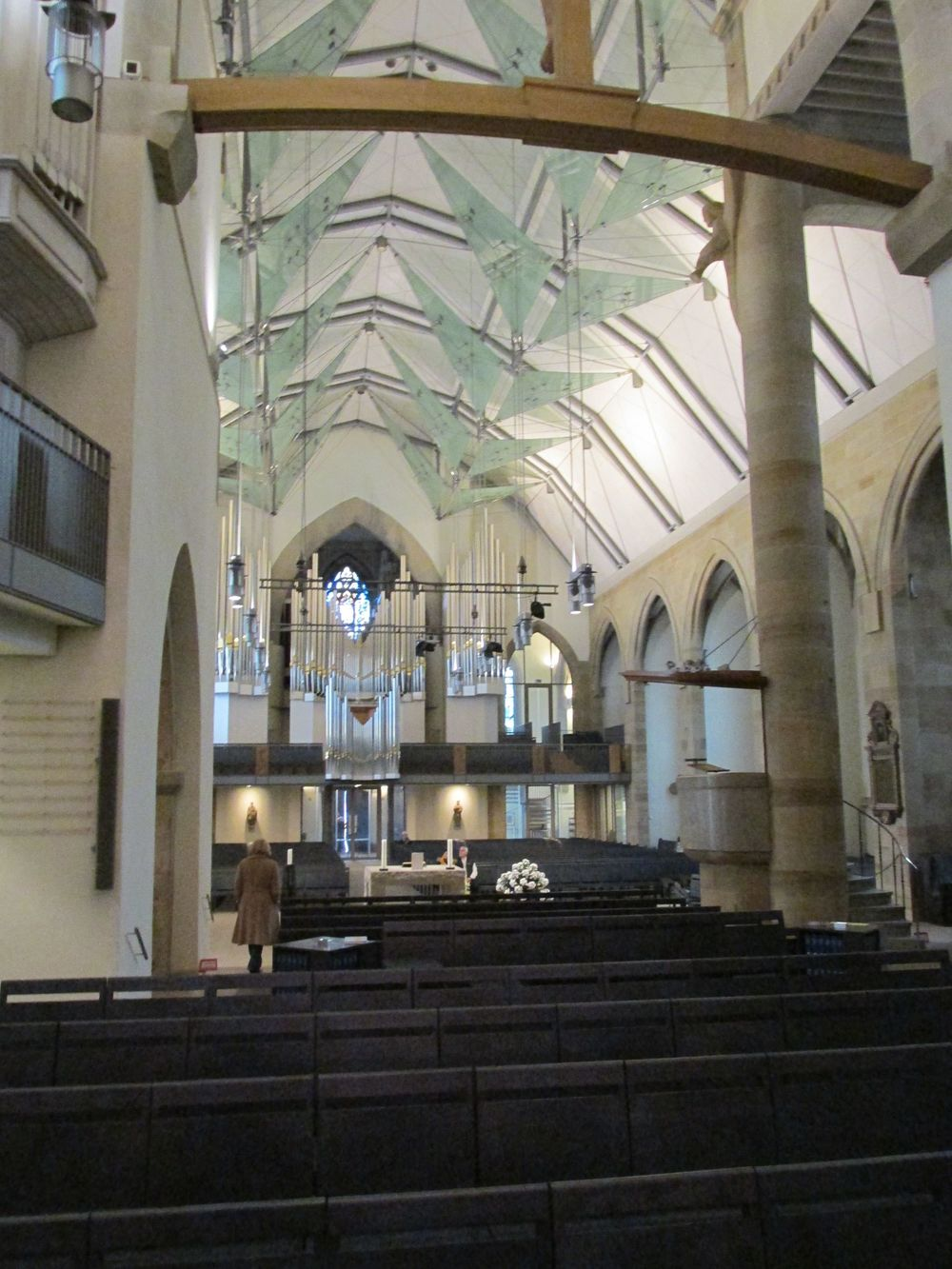 The Stiftskirche restored. A 1950s barrel vault slathered with asbestos was removed in favor of a gothic quotation in the vaulting and glass panels during a renovation completed in 2003.