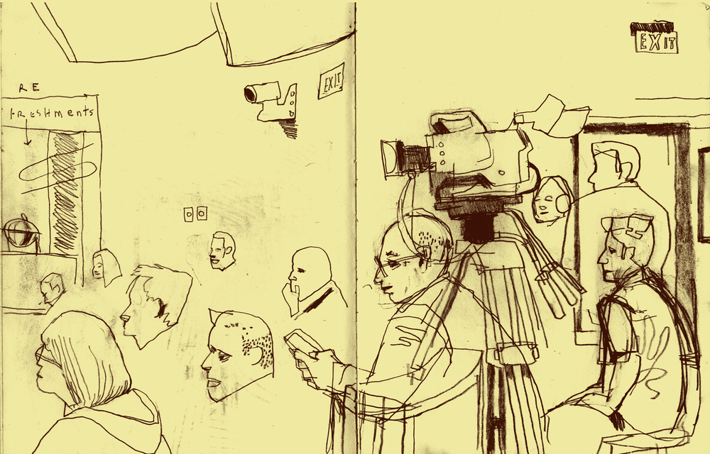 Dowd, illustration, Videographers in Emerson Auditorium. This drawing started in the morning, early, with the cameras in place, accompanied by bored shooters. I returned to it later in the day, when the crowd had filled in. The heads dotting the left half of the spread provided an interesting problem. How many would be enough?