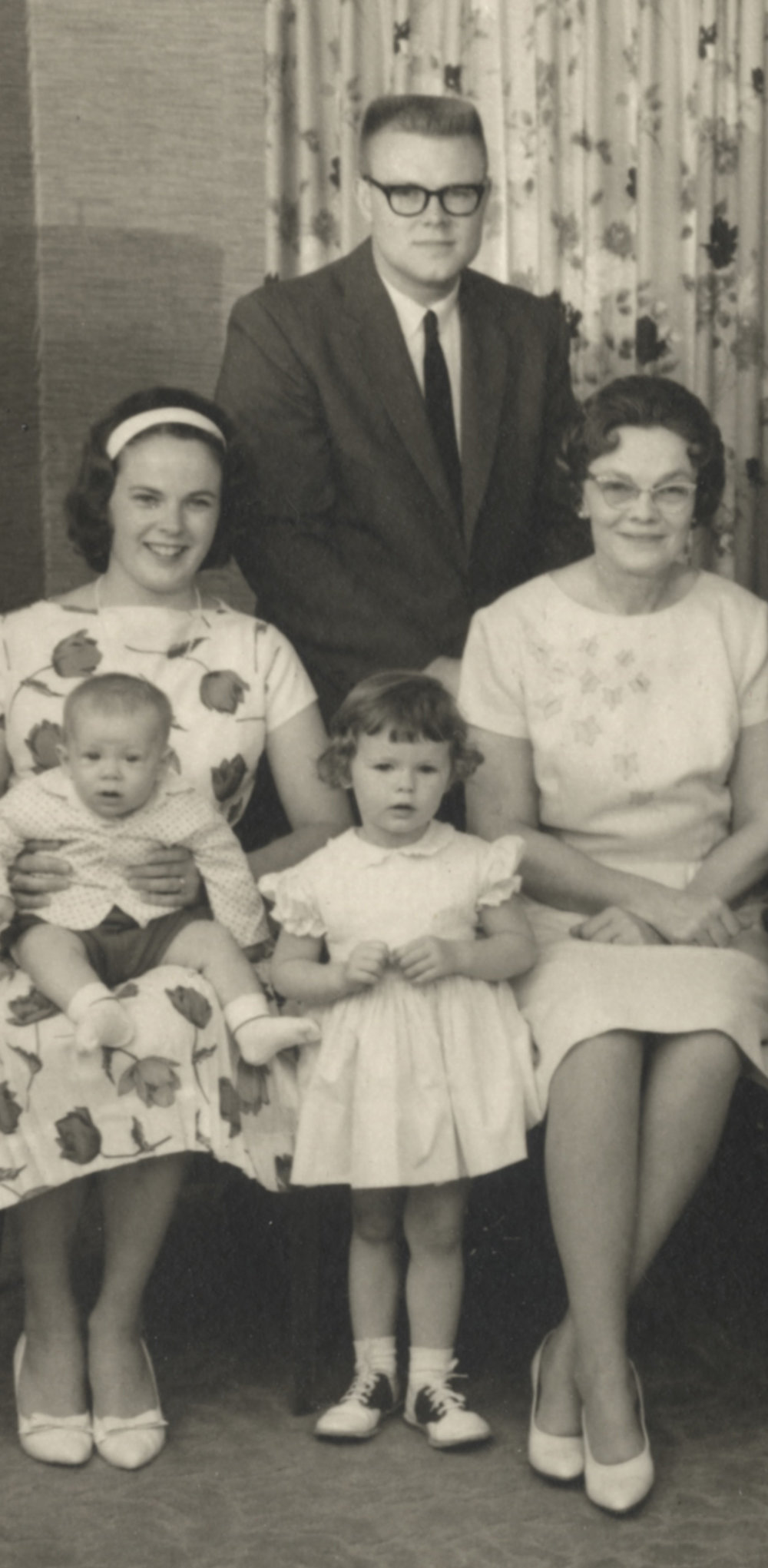 "Jim Dowd, in the back; Betty Dowd with Ken Dowd in her lap; Debbie Dowd (now Clinebell) standing center; Martha Combrink Dowd (Jim's mother, my grandmother) at right. This is a detail from a much larger family photograph shot at 1021 Oxford in 1965. That conservative-looking guy in the back was a freedom rider in the South and on the scene for the March on Washington. He heard Martin Luther King Jr.'s ""I Have a Dream"" speech live. (The audio was garbled and difficult to follow.)"