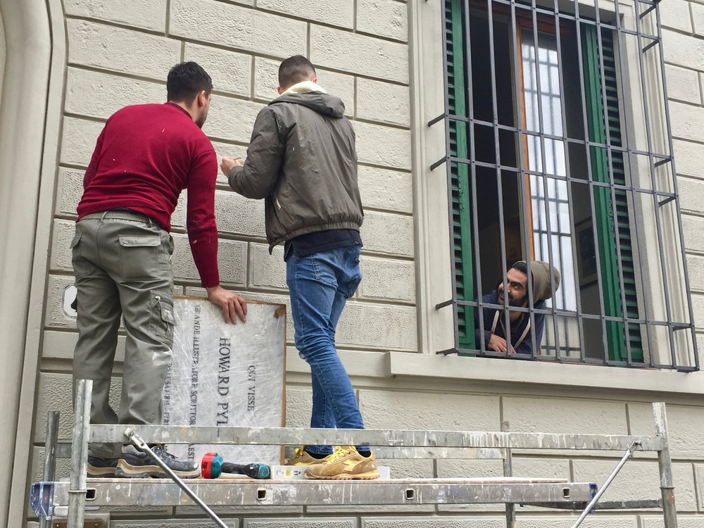 Howard Pyle Plaque Installation , photograph by Jeff Pike (with Rockwellian Flourish of guy in window), Florence, Italy, March 11, 2018.
