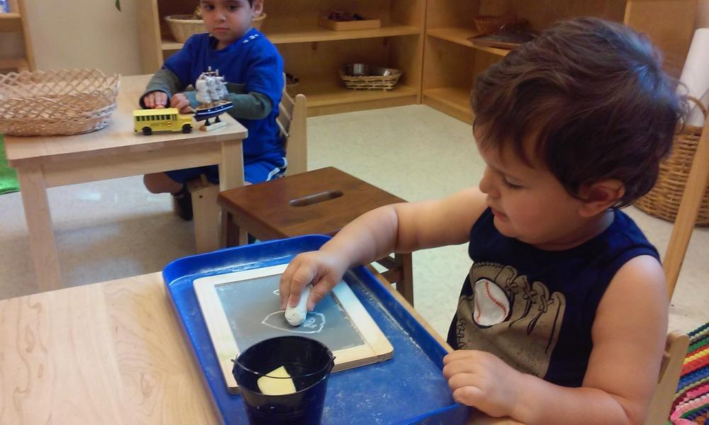 Butterflies:  Alex working hard writing on the chalkboard!